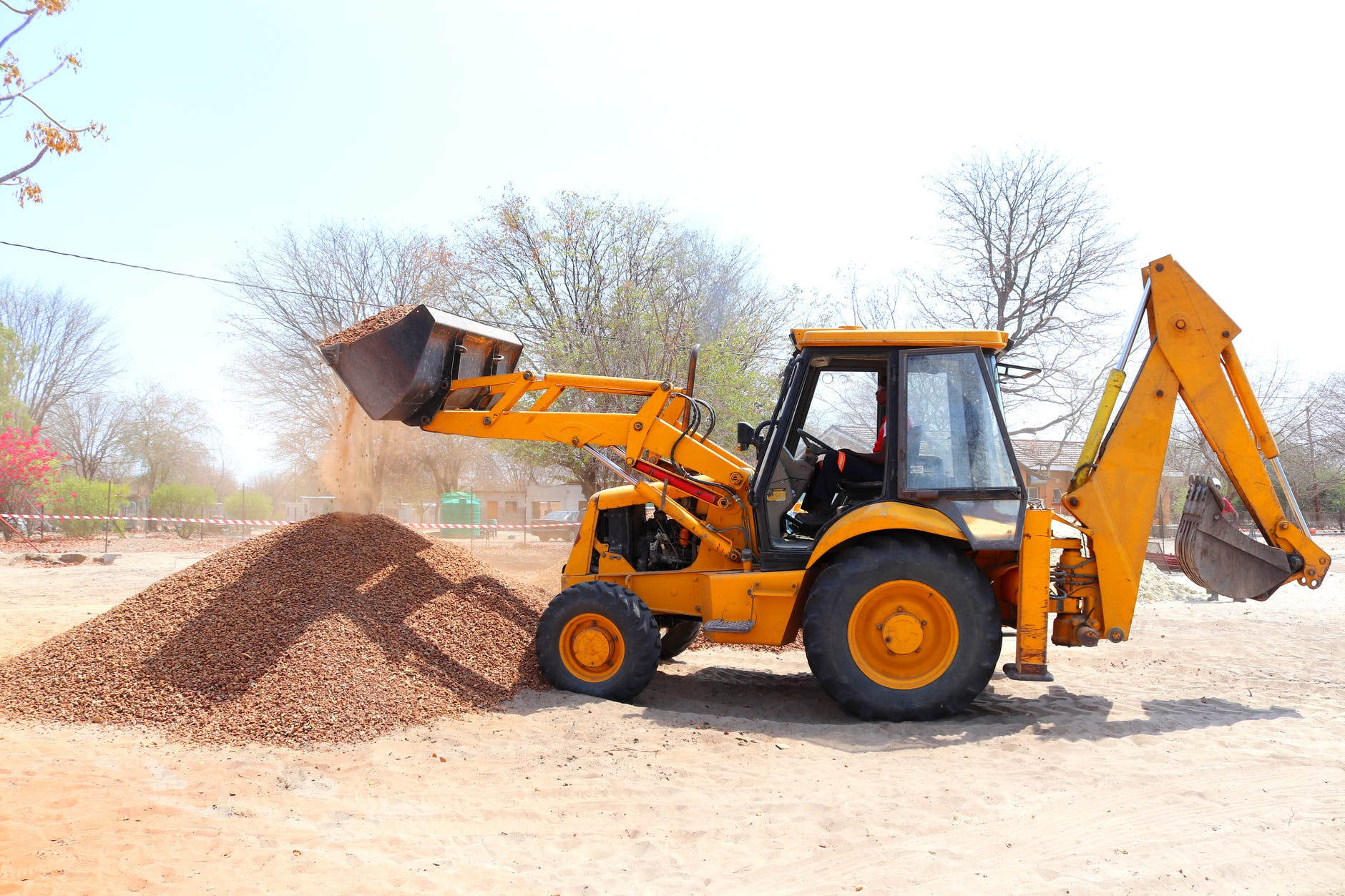 yellow front loader at construction site
